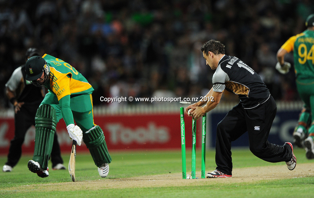 South Africa's Richard Levi is almost run out by Nathan McCullum during the 2nd InternationaI Twenty20 cricket match between New Zealand Black Caps and South Africa at Seddon Park, Hamilton, New Zealand on Sunday 19 February 2012. Photo: Andrew Cornaga/Photosport.co.nz