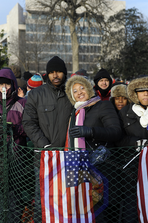 Dionne (R) and Damien (L) Calhoun of Washington, D.C. arrive at the reflecting pool at the Capital carrying an Hawaiian flag for the swearing in of Barack Obama as the 44th President of the United States of America during his Inauguration Ceremony on Capitol Hill in Washington on January 20, 2009.    (Mark Goldman/ Goldmine Photos)