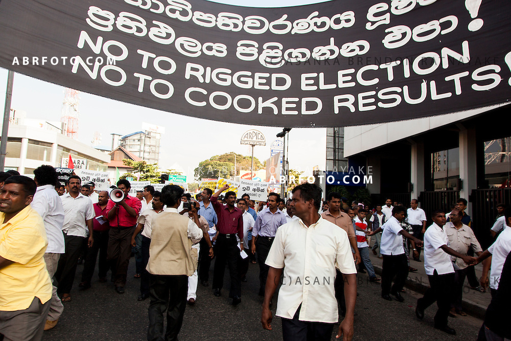 A large banner reading 'No to rigged election, No to cooked Results' during a Democratic National Alliance protest led by Sarath Fonseka after losing the 2010 Sri Lankan Presidential Election in COlombo Sri Lanka