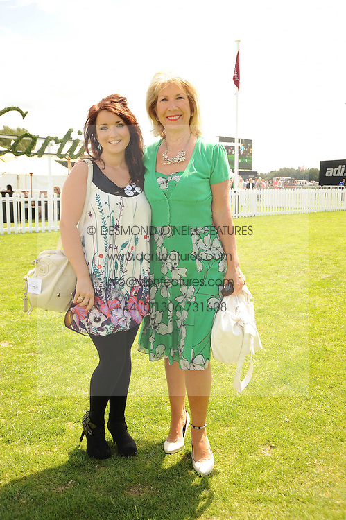 JENNIE BOND and her daughter EMMA KELTZ at the Cartier International Polo at Guards Polo Club, Windsor Great Park, Berkshire on 25th July 2010.
