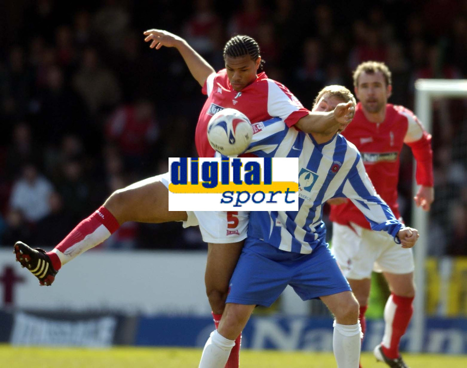 Photo: Jonathan Butler.<br />Swindon Town v Hartlepool United. Coca Cola League 1. 08/04/2006.<br />Swindon's Jerel Ifil (lt) wins the ball.