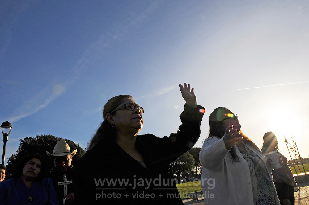 """Family and friends pray at a somber mid-November ceremony in Closter Park in Salinas. The group """"A Time for Grieving and Healing"""" led by Debbie Aguilar unveiled a memorial to the numerous victims of violence in Monterey County since 1988."""