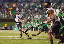 Oct 9, 2015; Huntington, WV, USA; Southern Miss Golden Eagles quarterback Nick Mullens attempts to throw to the end zone during the second quarter against the Marshall Thundering Herd at Joan C. Edwards Stadium. Mandatory Credit: Ben Queen-USA TODAY Sports