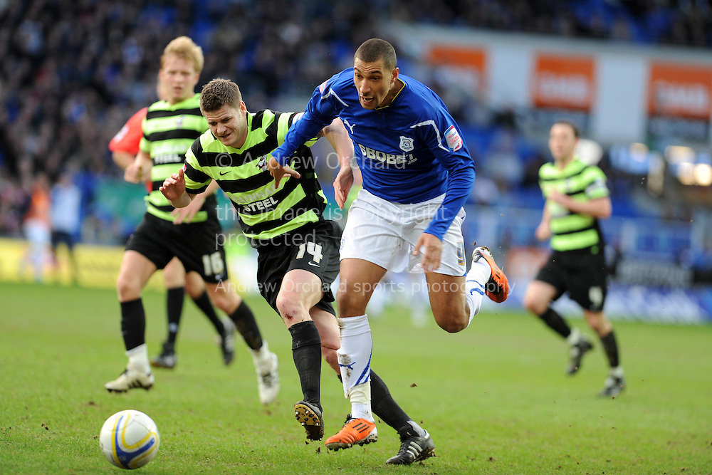 Cardiff city's Jay Bothroyd (r) holds off Scunthorpe's Michael Nelson. NPower championship. Cardiff city v Scunthorpe Utd at the Cardiff city stadium in Cardiff on Sat 12th Feb 2011. pic by Andrew Orchard, Andrew Orchard sports photography,