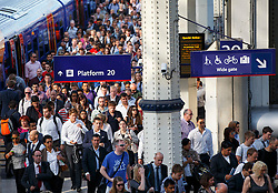© Licensed to London News Pictures. 09/07/2015. London, UK. Commuters arriving Waterloo train station on overground trains as tube strike shuts down the entire London Underground network on Thursday, July 9, 2015. The strike called by RMT, TSSA and Unite unions is a 27-hour stoppage by about 20,000 Tube staff and shuts down the entire London Underground network. Photo credit: Tolga Akmen/LNP