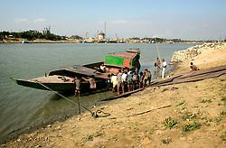 BANGLADESH SYLHET CHHATTAK 24FEB05 - Labourers load heavy steel plates onto a barge near Chhattak, close to border with India/Meghalay..jre/Photo by Jiri Rezac ..© Jiri Rezac 2005..Contact: +44 (0) 7050 110 417.Mobile:  +44 (0) 7801 337 683.Office:  +44 (0) 20 8968 9635..Email:   jiri@jirirezac.com.Web:    www.jirirezac.com..© All images Jiri Rezac 2005- All rights reserved.