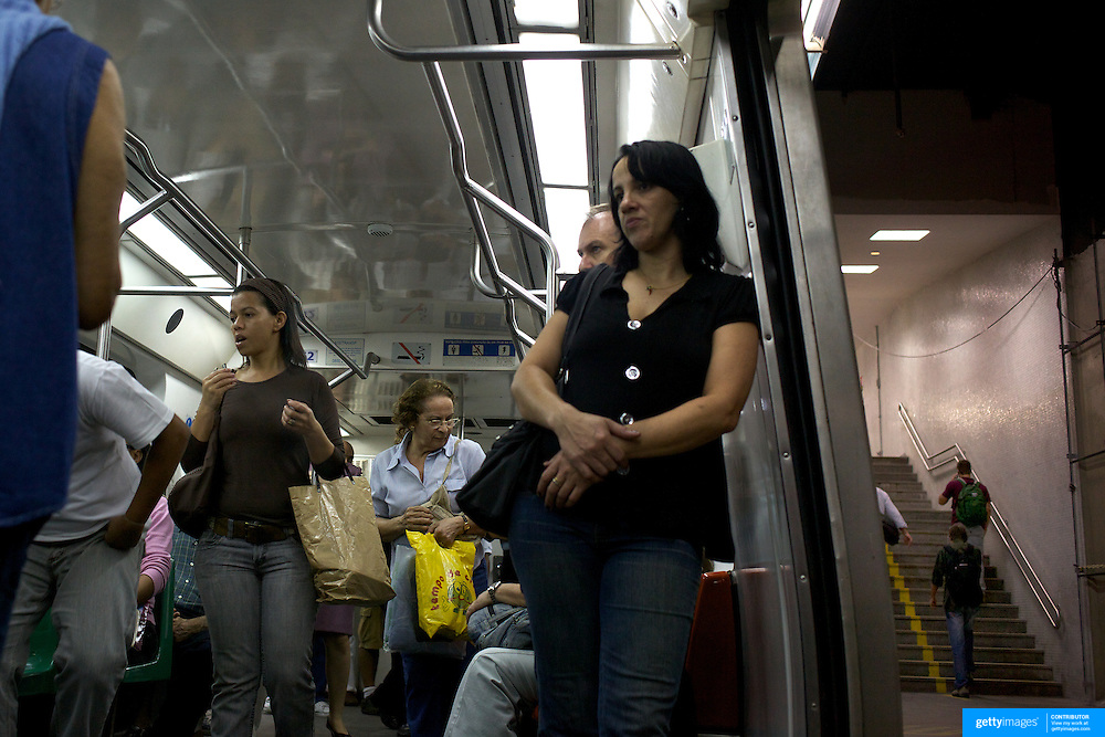Commuters using the metro rail transport system in Rio de Janeiro,  Brazil. 19th July 2010. Photo Tim Clayton..