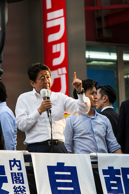 TOKYO, JAPAN - JULY 03 : Japanese Prime Minister Shinzo Abe, president of the ruling Liberal Democratic Party greets the voters during the July 10 Upper House election campaign in Shibuya crossing, Tokyo prefecture, Japan, on July 3, 2016. Photo: Richard Atrero de Guzman