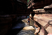 Hiker cools off, Deer Creek Canyon, river mile 136, Grand Canyon National Park, Arizona..Subject photograph(s) are copyright Edward McCain. All rights are reserved except those specifically granted by Edward McCain in writing prior to publication...McCain Photography.211 S 4th Avenue.Tucson, AZ 85701-2103.(520) 623-1998.mobile: (520) 990-0999.fax: (520) 623-1190.http://www.mccainphoto.com.edward@mccainphoto.com.