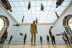 """© Licensed to London News Pictures. 17/09/2019. LONDON, UK. Visitors view """"Lost Horizon I"""", 2008, by Antony Gormley, which comprises 24 cast iron body forms. Preview of a new exhibition by Antony Gormley at the Royal Academy of Arts.  The show bring together existing and specially conceived new works from drawing to sculptures to experimental environments to be displayed in all 13 rooms of the RA's Main Galleries 21 September to 3 December 2019.  Photo credit: Stephen Chung/LNP"""