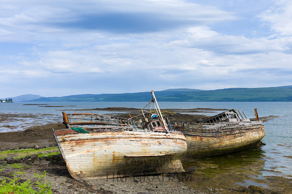 Disused rusty derelict fishing boats at Salen Bay in Sound of Mull on Isle of Mull in the Inner Hebrides and Western Isles, West Coast of Scotland