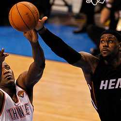 Jun 14, 2012; Oklahoma City, OK, USA; Miami Heat small forward LeBron James (6) and Oklahoma City Thunder center Kendrick Perkins (5) battle for a rebound during the third quarter of game two in the 2012 NBA Finals at Chesapeake Energy Arena. Mandatory Credit: Derick E. Hingle-US PRESSWIRE