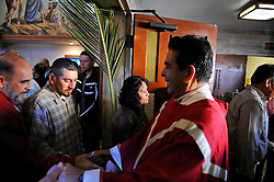 Msgr. Daniel Lopez of El Cristo Rey greets parishioners as they leave the 9:00 AM Mass on Palm Sunday in Salinas.