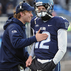 TOM KELLY IV &mdash; DAILY TIMES<br /> Villanova QB Chris Polony (12) and QB John Robertson (19) who was sidelined with a concussion talk on the sideline during the Sam Houston State University at Villanova University NCAA FCS Division 1 - AA quarterfinal game at Villanova Stadium.