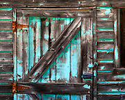 A weathered barn door shows signs of a brighter time. Oakley, Utah. Colin Braley/Photo