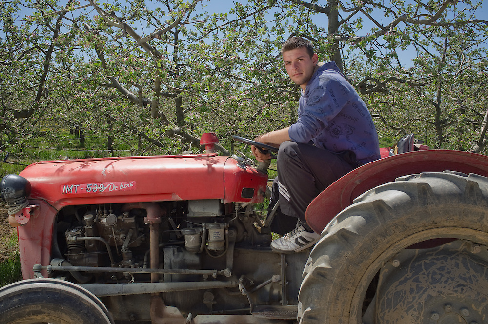 Pece (22) on his tractor, near Resen, FYR Macedonia