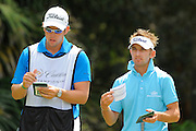 Jbe' Kruger and his caddie during the first round of the World Golf Championship Cadillac Championship on the TPC Blue Monster Course at Doral Golf Resort And Spa on March 8, 2012 in Doral, Fla. ..©2012 Scott A. Miller.