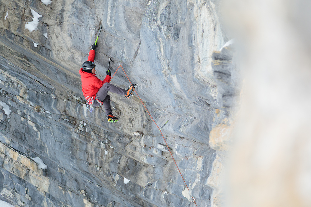 Jo Pung climbing Slaughterhouse behind Ice Nine in Banff National Park