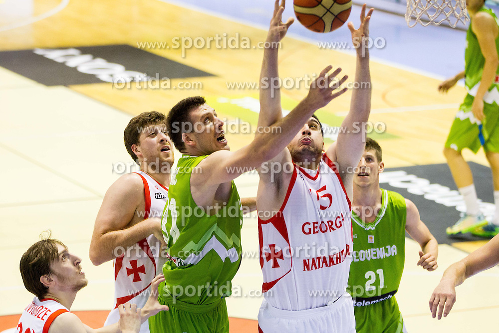 Matej Krusic of Slovenia vs Beka Burjanadze of Georgia during friendly basketball match between National teams of Slovenia and Georgia in day 2 of Adecco Cup 2014, on July 25, 2014 in Dvorana OS 1, Murska Sobota, Slovenia. Photo by Vid Ponikvar / Sportida.com