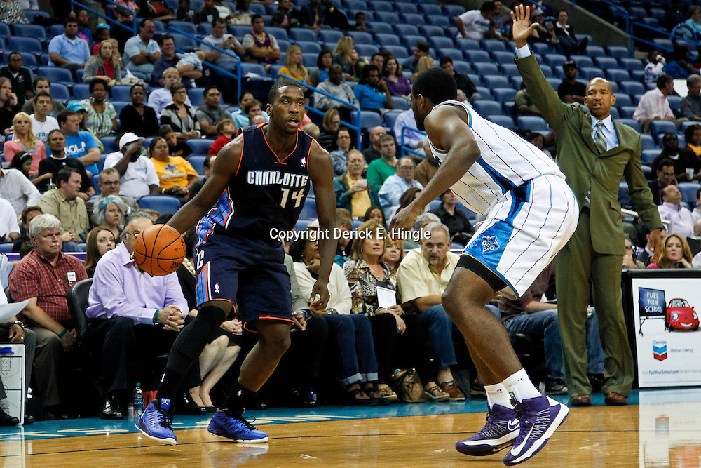 October 9, 2012; New Orleans, LA, USA; Charlotte Bobcats forward Michael Kidd-Gilchrist (14) is guarded by New Orleans Hornets forward Darius Miller (2) during the fourth quarter of a preseason game at the New Orleans Arena. The Hornets defeated the Bobcats 97-82.  Mandatory Credit: Derick E. Hingle-US PRESSWIRE