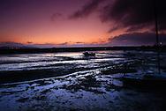 Dawn over Cockwood Harbour mudflats at low tide.  Cockwood Harbour, Exe Estuary,  Devon, England.