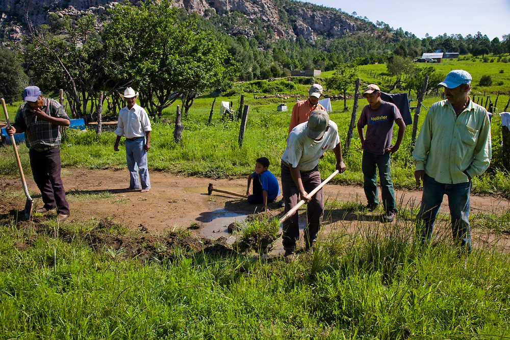 Rancher José Angel Galaviz (center with a shovel in his hands) works with his neighbors near his home in the Sierra Mountains  near Maycoba, in the Mexican state of Sonora. (José Angel Galaviz Carrillo is featured in the book What I Eat: Around the World in 80 Diets.)