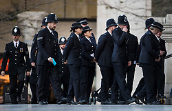 © Licensed to London News Pictures. 14/12/2017. London, UK. Members of the police service local to Grenfell arrive at St Paul's Cathedral in London for a Grenfell Tower National Memorial Service to mark the six month anniversary of the Grenfell Tower fire. The service is attended by survivors of the fire and relatives of those who lost their lives in the fire, as well as members of the emergency services and members of the Royal family.  Over 70 people were killed when a huge fire ripped though 24-storey Grenfell Tower block in west London in June 2017.   Photo credit: Ben Cawthra/LNP