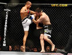 August 8, 2009; Philadelphia, PA; USA; BJ Penn (white trunks) and Kenny Florian (black trunks) fight for Penn's UFC Lightweight Championship title at the Wachovia Center in Philadelphia, PA.  Penn won via rear naked choke.