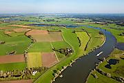 Nederland, Gelderland, Gemeente Voorst, 03-10-2010; De Voorster Klei, gezien naar het noorden, Deventer aan de verre horizon. In het kader van het programma Ruimte voor de Rivier zal in het gebied een dijkverlegging plaats vinden. Er komt een nieuwe dijk meer landinwaarts (geheel links), het eerste deel van de bestaande bandijk (onder in beeld) wordt gedeeltelijk verlaagd en sommige huizen moeten waarschijnlijk worden geamoveerd. Het middendeel van de oude dijk blijft bestaan. .Voorster 'clay' seen to the north, Deventer on the distant horizon. A new dike will be build, more inland and the first part of the existing dike (bottom) wil be partially reduced in height, creating 'more space for the river'. Some houses will have to be be demolished..luchtfoto (toeslag), aerial photo (additional fee required).foto/photo Siebe Swart