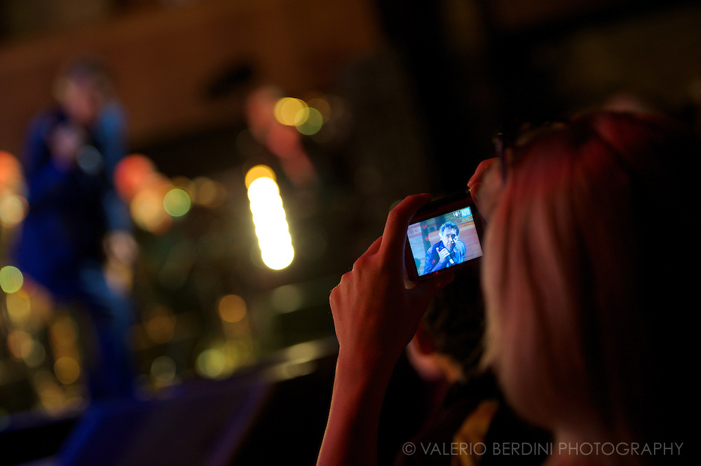 A fan snaps a photo of Bryan Ferry at the Corn Exchange in Cambridge on 31 October 2013