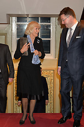 HRH The DUCHESS OF CORNWALL and EWAN VENTERS Fortnum & Mason's CEO at a party to celebrate the publication of 'Let's Eat meat' by Tom Parker Bowles held at Fortnum & Mason, Piccadilly, London on 21st October 2014.