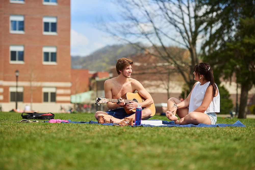 Activity; Relaxing; Buildings; Bluffs; Eagle Hall; Location; Outside; People; Student Students; Woman Women; Man Men; Spring; April; Time/Weather; sunny; Type of Photography; Candid; UWL UW-L UW-La Crosse University of Wisconsin-La Crosse; Guitar <br /> Katie Queram marketing<br /> Patrick Rath marketing guitar