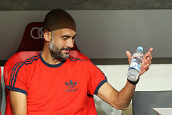 04.08.2015, Allianz Arena, Muenchen, GER, AUDI CUP, FC Bayern Muenchen vs AC Mailand, im Bild Trainer Pep Guardiola (FC Bayern Muenchen) auf der Trainerbank mit Wasserflasche // during the 2015 AUDI Cup Match between FC Bayern Muenchen and AC Mailand at the Allianz Arena in Muenchen, Germany on 2015/08/04. EXPA Pictures © 2015, PhotoCredit: EXPA/ Eibner-Pressefoto/ Schüler<br /> <br /> *****ATTENTION - OUT of GER*****