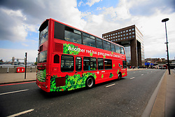 UK ENGLAND LONDON 12MAY10 - A route 141 double decker bus makes it way across London Bridge in central London. The route 141 buses have been fitted with a hybrid diesel electric drive technology reducing carbon emissions of the fleet by up to 40 per cent per bus...jre/Photo by Jiri Rezac..© Jiri Rezac 2010