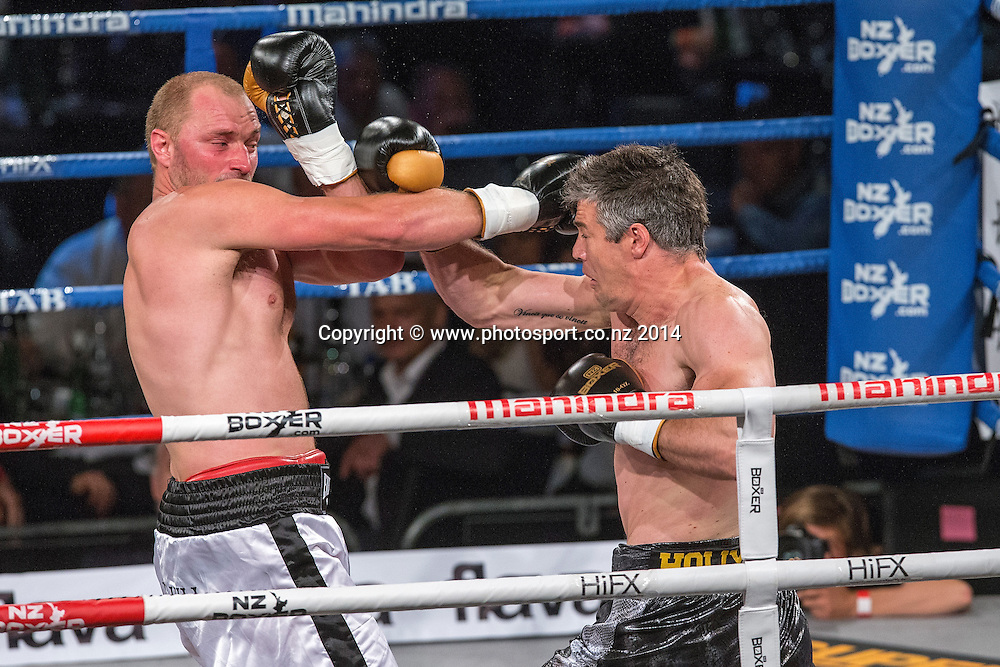 Daniel Ammann (L) fights Brad `Hollywood` Pitt in the Mahindra Super 8 Fight Night, North Shore Events Centre, Auckland, New Zealand, Saturday, November 22, 2014. Photo: David Rowland/Photosport