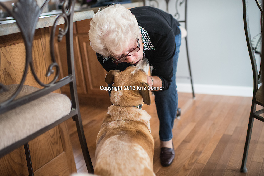 """""""We spoil them,"""" Steiniger gives one of her two dogs """"Bo"""" a kiss at home."""