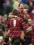 © Peter Spurrier/ Intersport Images.Photo Peter Spurrier.01/03/2003 Sport - Semi final Powergen Cup Rugby -.Leicester  v Gloucester - Franklin Gardens.Andy Gomersll celebrates the victory as he jestures to the bench after being lifted by James Forrester,.