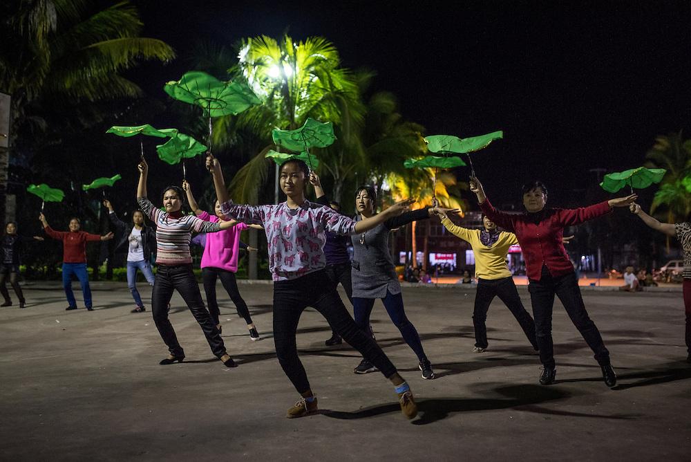 Women practice for a dance competition in Simaogangzhen, Yunan, China.