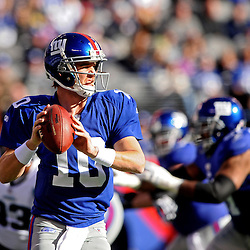 Quarterback Eli Manning #10 of the New York Giants scrambles from the pocket during NFL football action between the New York Giants and Jacksonville Jaguars on Nov. 28, 2010 at MetLife Stadium in East Rutherford, N.J.