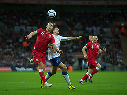 LONDON, ENGLAND - Tuesday, September 6, 2011: Wales' Darcy Blake and England's Stewart Downing during the UEFA Euro 2012 Qualifying Group G match at Wembley Stadium. (Pic by Gareth Davies/Propaganda)