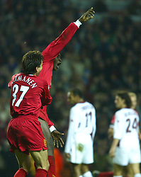 LIVERPOOL, ENGLAND - Tuesday, March 19, 2002: Liverpool's Emile Heskey celebrates with Jari Litmanen after scoring the second against AS Roma during the UEFA Champions League Group B match at Anfield. (Pic by David Rawcliffe/Propaganda)