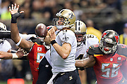 NEW ORLEANS, LA - SEPTEMBER 20:  Drew Brees #9 of the New Orleans Saints has his arm hit while trying to throw a pass during a game against the Tampa Bay Buccaneers at Mercedes-Benz Superdome on September 20, 2015 in New Orleans Louisiana.  The Buccaneers defeated the Saints 26-19.  (Photo by Wesley Hitt/Getty Images) *** Local Caption *** Drew Brees