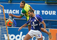 09 December 2006, Brazils captain Buru and Frances Dideir Samoun contest a high ball during their game at the Vodacom Pro Beach Soccer Tour in Durban's Bay of Plenty on Saturday. Brazil won the game 9-5. Picture: Shayne Robinson, PhotoWire Africa