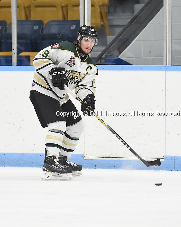 MARKHAM, ON - NOV 11,  2016: Ontario Junior Hockey League game between Cobourg and Markham, Josh Maguire #19 of the Cobourg Cougars passes the puck during the second period.<br /> (Photo by Andy Corneau / OJHL Images)