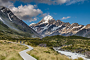 The peak of Aoraki / Mount Cook (3755 meters / 12,349 feet) rises majestically above the Hooker Valley Track, in Aoraki / Mount Cook National Park, Southern Alps, Canterbury region, South Island, New Zealand. In 1990, UNESCO honored Te Wahipounamu - South West New Zealand as a World Heritage Area.