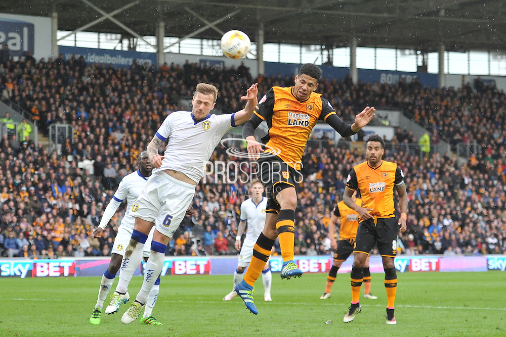 Hull City defender Curtis Davies (6) heads towards goal  during the Sky Bet Championship match between Hull City and Leeds United at the KC Stadium, Kingston upon Hull, England on 23 April 2016. Photo by Ian Lyall.