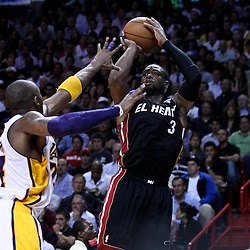 March 10, 2011; Miami, FL, USA; Miami Heat shooting guard Dwyane Wade (3) shoots over Los Angeles Lakers shooting guard Kobe Bryant (24) during the third quarter at the American Airlines Arena. The Heat defeated the Lakers 94-88.   Mandatory Credit: Derick E. Hingle