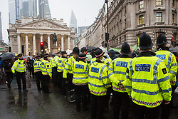 London, UK. 14 October, 2019. Police officers form a cordon in order to attempt to disperse climate activists from Extinction Rebellion who had been occupying the busy junction in front of the Bank of England since 7am on the eighth day of International Rebellion protests.