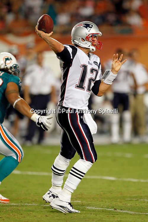New England Patriots quarterback Tom Brady (12) throws a third quarter pass good for a first down during the NFL week 1 football game against the Miami Dolphins on Monday, September 12, 2011 in Miami Gardens, Florida. The Patriots won the game 38-24. ©Paul Anthony Spinelli