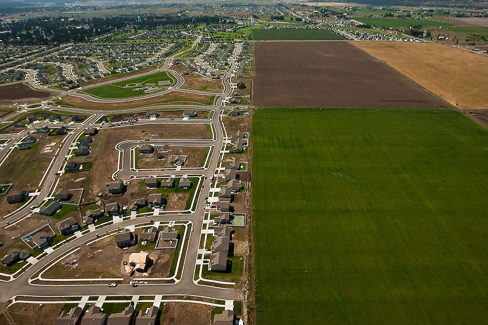 An incomplete subdivision pushes up against the edge of agricultural land on the Rathdrum Prairie in Post Falls, Idaho on Aug. 21, 2009.